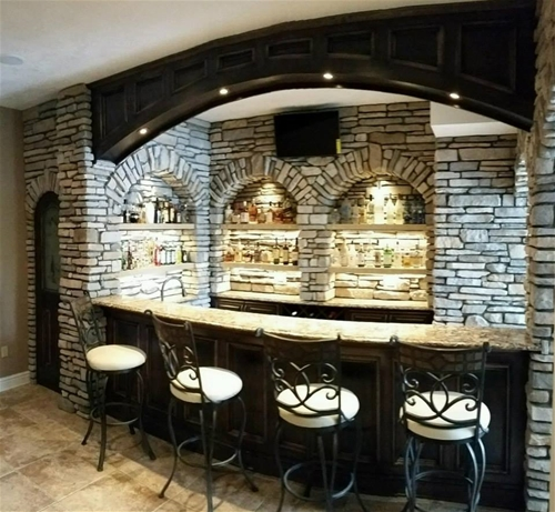 home basement bar made utilizing maple hardwood for the arch, door, & bar front