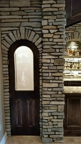 custom made cellar door with an etched glass panel