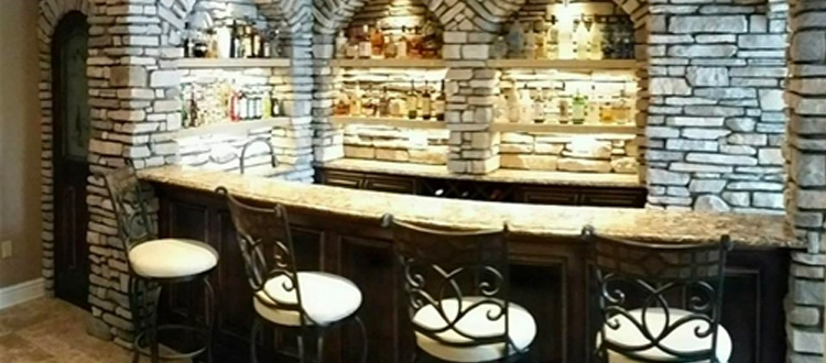 home basement bar made utilizing maple hardwood for the arch, doo, bar front and cabinets